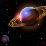 Planet with rings at sunrise on the background Royalty Free Stock Photo