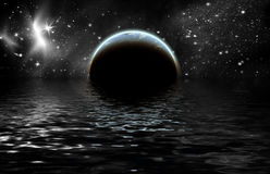 Planet in space. Reflected in water Royalty Free Stock Image
