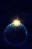 Planet in space against the sun Royalty Free Stock Image