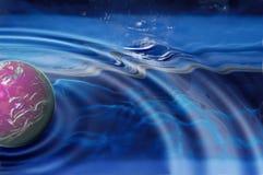Planet splashing Stock Photos