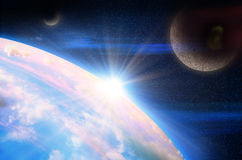 Planet with sunrise on the background of stars Stock Photography