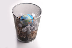 Planet Trashed In a Paper Dustbin. Copy-space Stock Photos