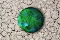 Planet und trockener Boden mit Sprung Lizenzfreies Stockbild