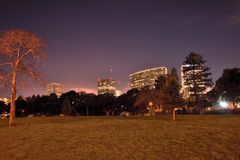 The Planet Venus In The Night Sky Over Downtown Oakland Stock Photos