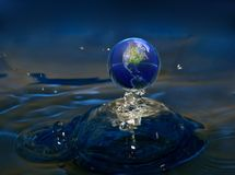 Planet water. Planet earth upon water with reflections Stock Photo