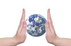 Planeta en palmas Imagen de archivo libre de regalías