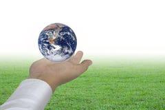 Planeta na mão humana foto de stock royalty free