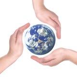 Planeta nas palmas Fotografia de Stock