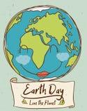 Planeta sonriente con la muestra del Día de la Tierra, ejemplo del vector Fotos de archivo