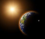 Planeta verdadero de la tierra en sol amarillo Fotos de archivo