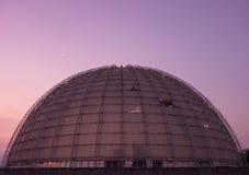 Planetarium dome, purple sky, moon. Dome of a planetarium on an amazing purple sky and the moon royalty free stock photos