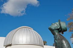 Planetarium and star gazer. Dome of Sir Thomas Brisbane planetarium with star gazing bronze statue of Russian Konstantin Tsiolkovsky (1857-1935), Soviet rocket royalty free stock photography