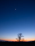 Planetary conjunction. On February 26, 2012, Venus, Jupiter and the crescent Moon formed a spectacular triangular conjunction in the Western sky after sunset Royalty Free Stock Photography