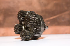 Planetary gear. S laying on table with copper background Royalty Free Stock Photography
