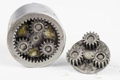 Planetary gear from a small device on a bright table. Gear wheel. S from a specialist device. White background royalty free stock photography