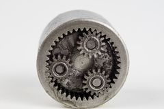 Planetary gear from a small device on a bright table. Gear wheel. S from a specialist device. White background royalty free stock image