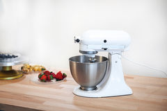 Planetary mixer on a table with fruit on a white background Stock Photos