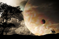 Planetary Sunset. A sunset image with a large planet in the background, with 2 moons Stock Photos