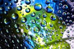Planetas de las burbujas del agua imagenes de archivo