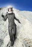 Planetas futuristas del espacio de la luna de la mujer del astronauta Imágenes de archivo libres de regalías