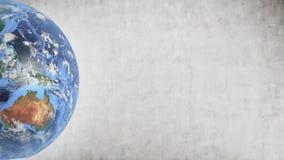 Planeten-Erde gegen Betonmauer, linkes Teil des Schirmes stockbild