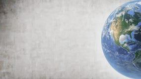 Planeten-Erde gelegen im rechten Teil des Schirmes und der Betonmauer stockfoto