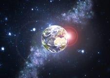 Planeten-Erde mit Sternen und Sun Stockfotografie