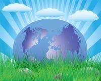 Planetenerde auf dem grünen Gras Lizenzfreie Stockfotografie