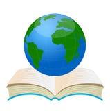 Planetenerde auf einem offenen Buch Lizenzfreies Stockfoto