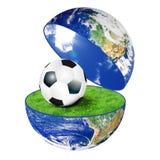 Planetjord med fotbollbollen Royaltyfria Bilder