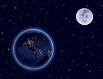 Planetjord och måne på natthimmel. Europa, Afrika och Asien. Arkivfoton