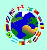 Planetjorden med dess kontinenter, hav, öar och med flaggorna av många länder Arkivbild