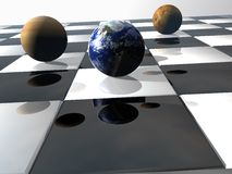 Planets on checkerboard. World and planets on checkerboard. 3D rendered graphic illustration Royalty Free Stock Images