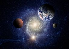 Planets of the solar system against the background of a spiral galaxy in space. Elements of this image furnished by NASA royalty free stock photos