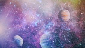 Planets, stars and galaxies in outer space showing the beauty of space exploration. Elements furnished by NASA. Space many light years far from the Earth Royalty Free Stock Photo