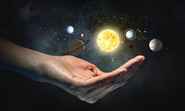 Planets of sun system. Close of businesswoman holding in palm planet of sun system Royalty Free Stock Photos