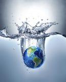 Planetuje ziemię, bryzga w wodę Zdjęcie Royalty Free
