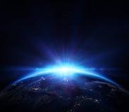 Planety ziemia z wschodem słońca w przestrzeni Zdjęcie Royalty Free