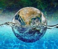 Planety ziemia zanurza w wodzie na tle gwiaździsty niebo obraz stock