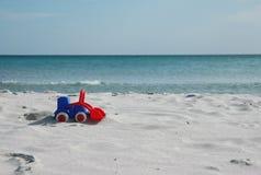 Planierraupe auf dem Strand Stockfotografie