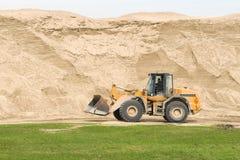 Planierraupe und Sand Stockfotografie
