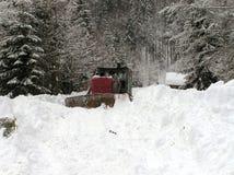 Planierraupen und Winter Stockfoto