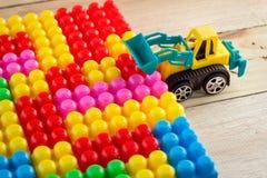 Planierraupenspielzeug vereinbaren Blockspielzeug jpg Lizenzfreies Stockfoto