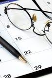 Planificación del nuevo mes de un calendario Imagen de archivo libre de regalías