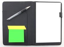 Planificador de la agenda del asunto con la pluma negra Fotos de archivo
