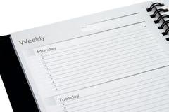Planificador semanal aislado Imágenes de archivo libres de regalías