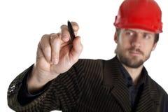 Planificateur dans un casque rouge Photo libre de droits