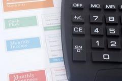Planificateur de budget avec la calculatrice noire Photographie stock