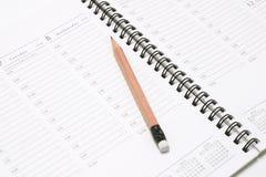 Planificateur de poche avec le crayon Image libre de droits