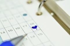 Planificateur de temps avec le stylo Image stock